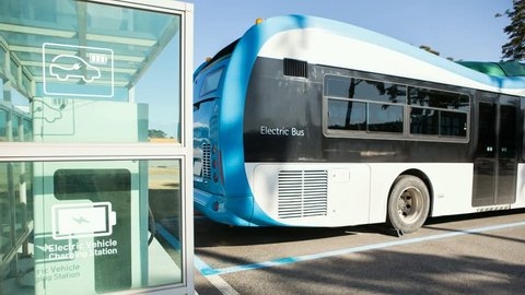 Electric bus stands at the charging station. His lights flash. Camera zoom moves forward