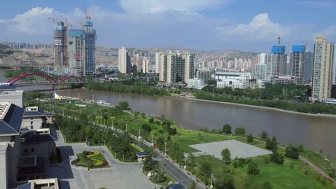 LANZHOU, CHINA - JULY 2017 - Urban view of Lanzhou, Gansu province, China, Asia with Yellow River. Landscape in Chinese city with skyline, modern buildings, skyscrapers, construction site