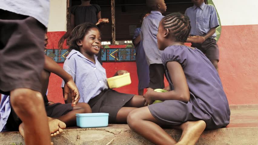 4k of African school children eating packed lunch at playtime break. | Shutterstock HD Video #33010000