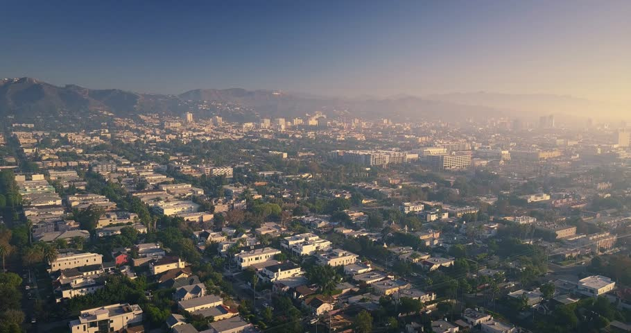 Scenic panorama of city of Los Angeles on a foggy morning at sunrise, camera descending and landing in an alley behind Melrose Avenue. 4K UHD. | Shutterstock HD Video #33035608