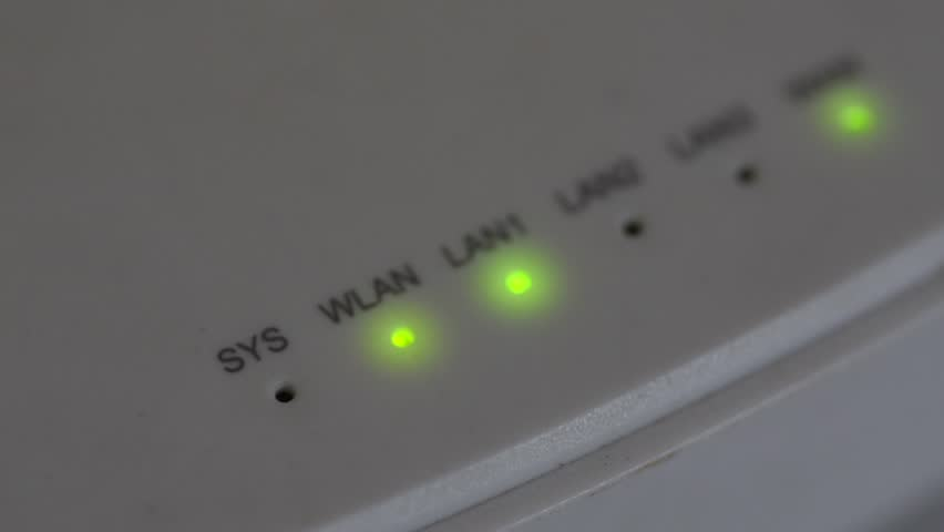 Modem router server LED lights, closeup, green lights, white color, loopable | Shutterstock HD Video #33036466