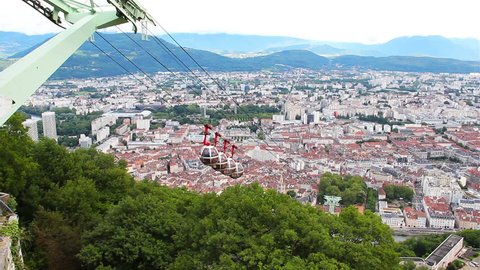 GRENOBLE, FRANCE - JUNE 19, 2016: Cable car from Grenoble downtown to Bastille fort and aerial view of Grenoble and French Alps from the Bastille hill