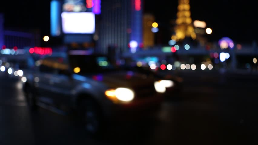 Cars in traffic on an intersection in Las Vegas at night. Soft off focus blur of Las Vegas Strip and shiny lights.   Shutterstock HD Video #33058642