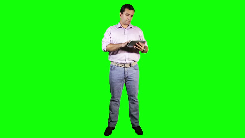 Young Man Tablet PC Full Body Greenscreen  Footage was shot against green screen and keyed out. The bg is pure green, removing the green is super easy. Green spills are removed.
