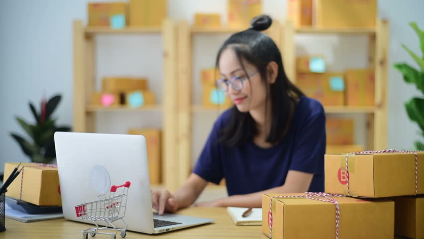 Young Asian Woman Working at home, Young business start up  | Shutterstock HD Video #33061420
