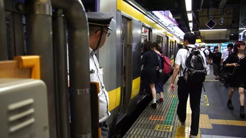 TOKYO, JAPAN - JUNE 2017:  Japanese metro train operator check time watch at the Tokyo subway station. Tokyo is a host city of 2020 Olympics