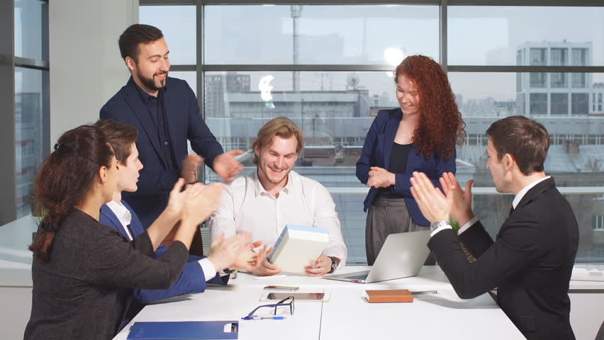 Portrait of young business team at work. Bright contemporary small creative business. Casual young people in new creative business office. | Shutterstock HD Video #33080521