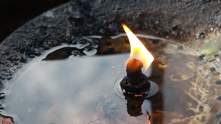 the candle and joss stick is the object for pray of buddhist in asia to worship and faith