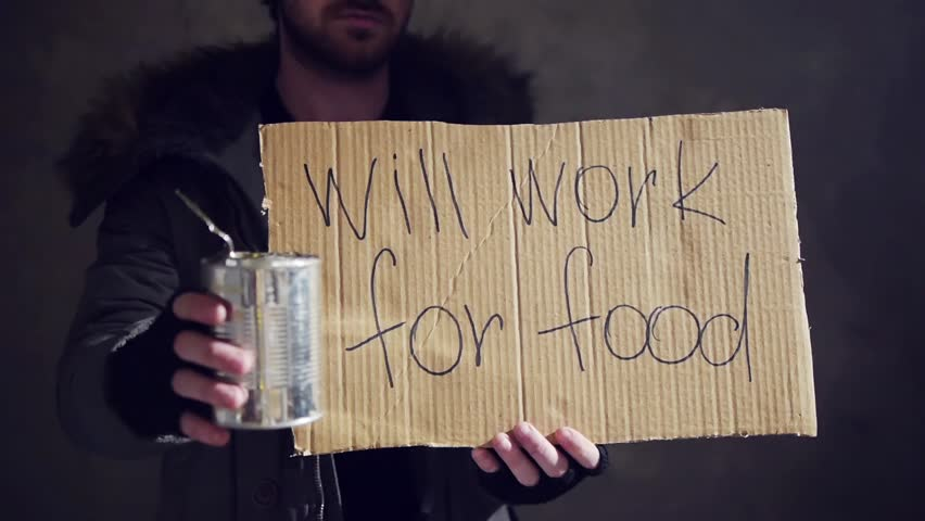 homeless hold out a tin and a cardboard with a sign