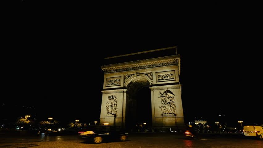 PARIS, FRANCE October 25, 2017: The famous sight Arc de Triomphe seen from Avenue des Champs-Élysées at night.