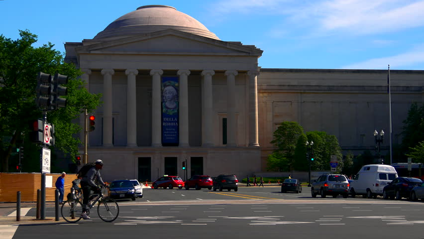 WASHINGTON DC - 2017: National Gallery of Art with Tourists Walking in front of Exterior Building