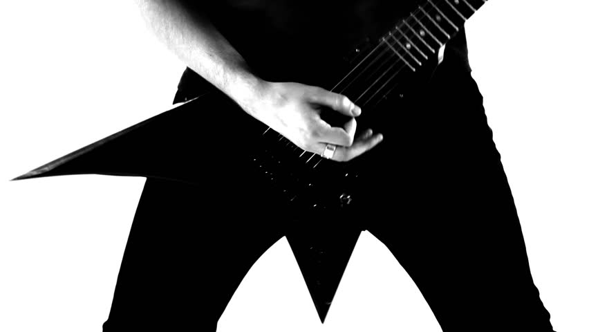 Musician playing guitar of an extraordinary shape. Black and white video.