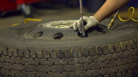 Repairing wheel by a mechanic. Old wheel repearing