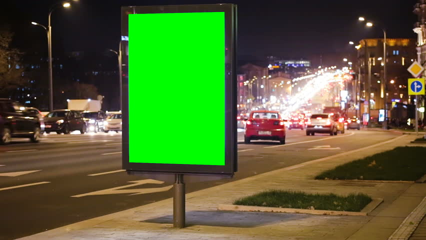 Board with a green screen on the night streets | Shutterstock HD Video #33159130