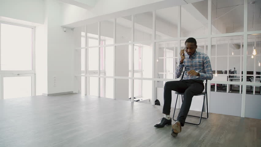 Successful young asian girl in a modern office skyscraper the work young businessman talking on phone while sitting in modern office hd stock video clip sciox Choice Image