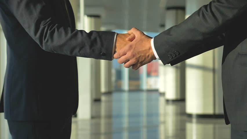 The two men handshake in the office hall. slow motion. around camera movement | Shutterstock HD Video #33182770