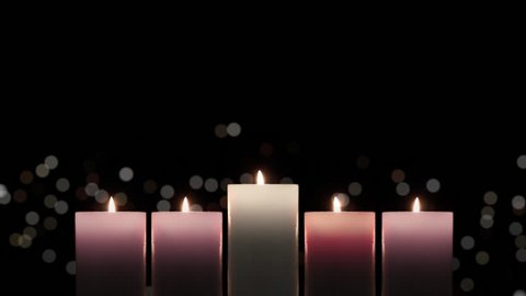 Advent candles looped background used to celebrate during the christmas season with the lighting of a candle each week leading up to christmas.