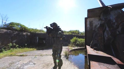 Soldier near old rusty AAA gun. Search and destroy operation.