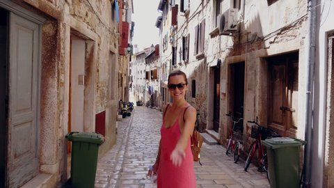 Woman walking narrow streets of a Rovinj, Croatia