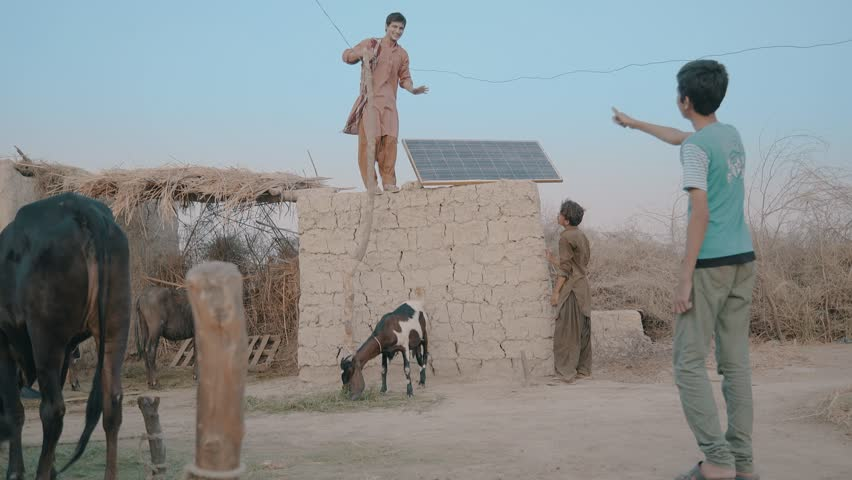 Villagers set up solar panel on the roof top, to bring in electricity in their small town village