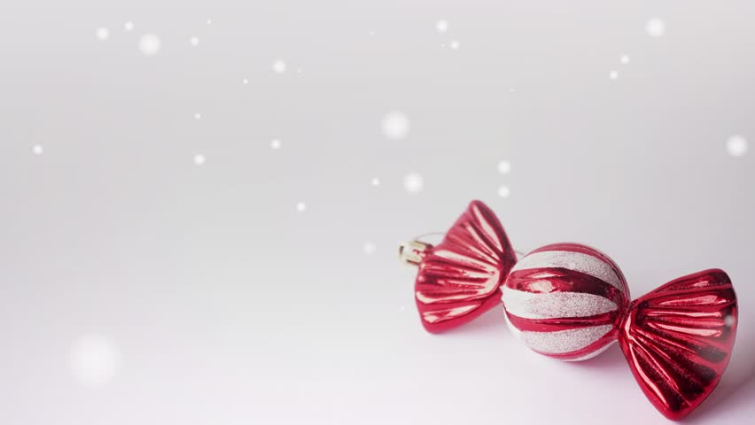 blank space, candy christmas decorations and falling snowflakes for christmas and new year background