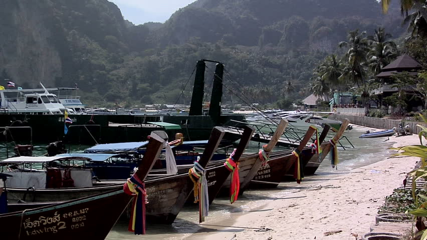 PHI PHI ISLAND, THAILAND - CIRCA FEBRUARY 2009: Decorated Long Boats on Ao Loh Da Lam Beach