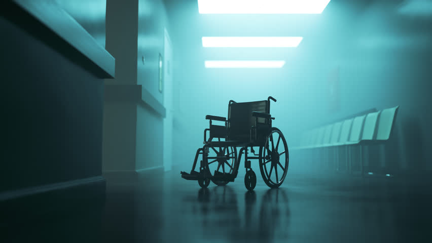 03004 Standard manual wheelchair in empty, foggy hospital corridor. Zoom in camera.