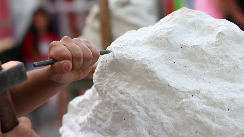 Young student at work learning craftsman profession in art class, working with hammer to carving stone statue from white stone | Shutterstock HD Video #33267550