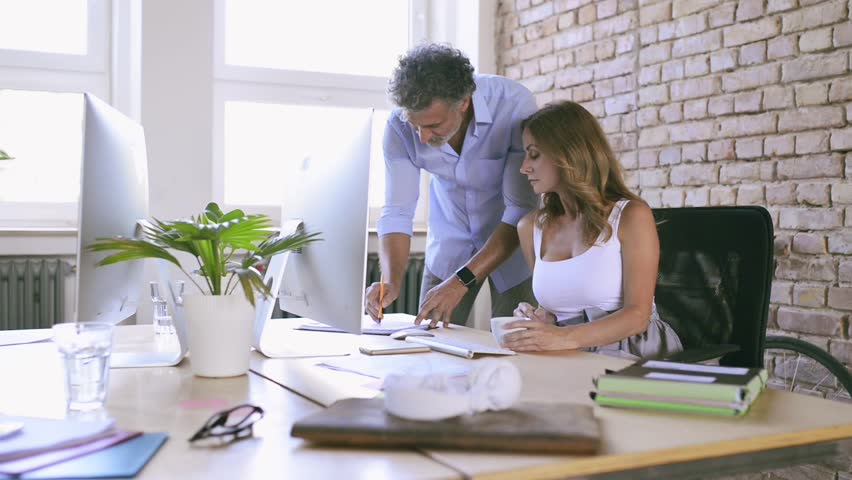 Business people in the office working together. | Shutterstock HD Video #33290335