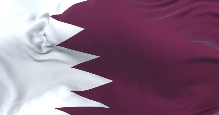 Qatar flag waving at wind in slow with blue sky, loop