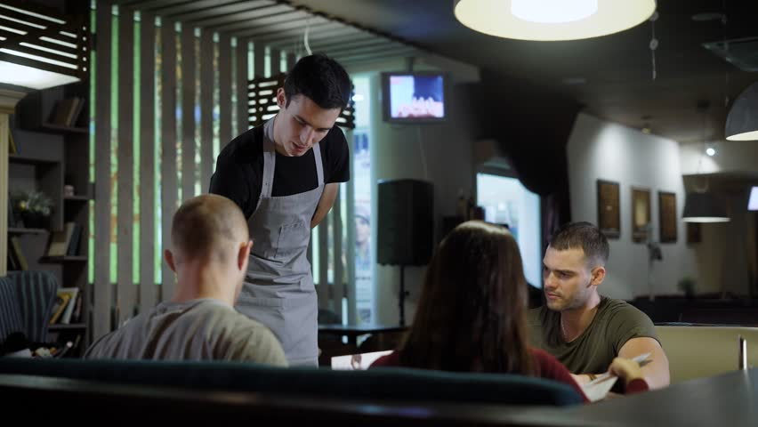 Waiter serving guests in cafe #33311770