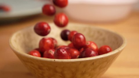 Fresh Cranberries falling in slow motion
