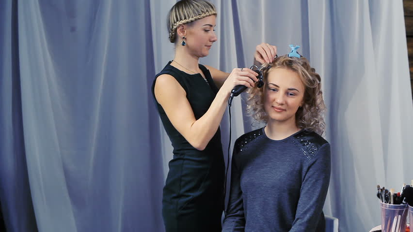 Hairdresser does a hairstyle for a girl | Shutterstock HD Video #33324970