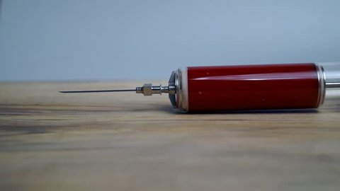 old Syringe with blood. background of health and medicine icon.