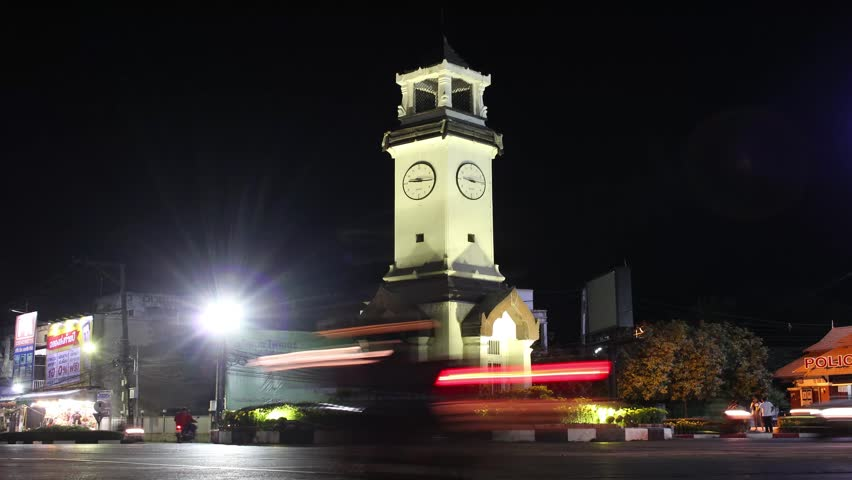 LAMPANG, THAILAND - November 25 : Landscape and cityscape with traffic with ancient clock tower roundabout of Lampang city in night time on November 25, 2017 in Lampang, Thailand