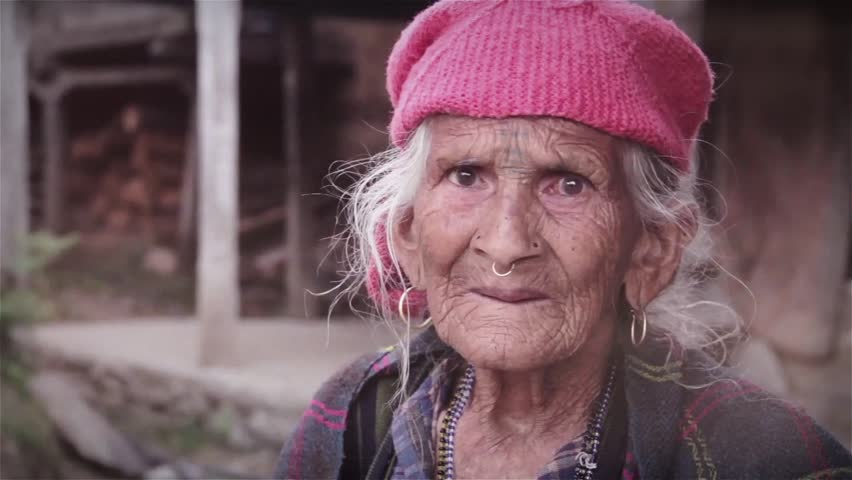 Close up and candid shot of a very old traditional Indian woman. Real people of India. Rural conservative lady