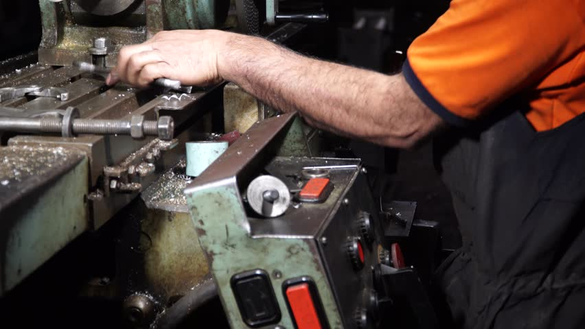 Manufacture of carbon gears by an industrial method on a lathe   Shutterstock HD Video #33385780