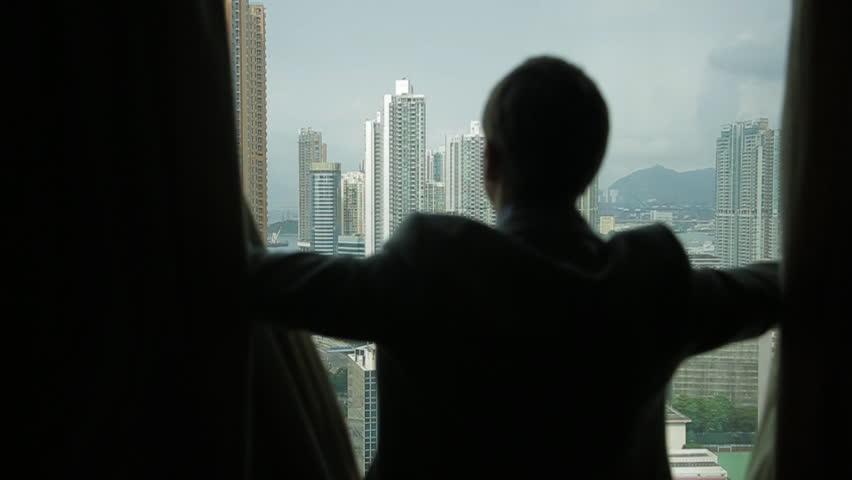Man opens curtains on the view Hong Kong | Shutterstock HD Video #3340250