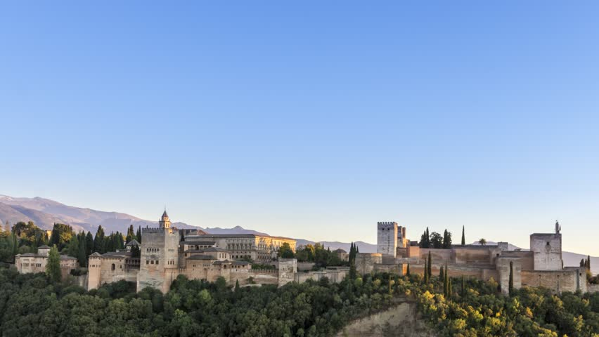 Classic view to Alhambra in Granada spain. Sunset to evening time lapse