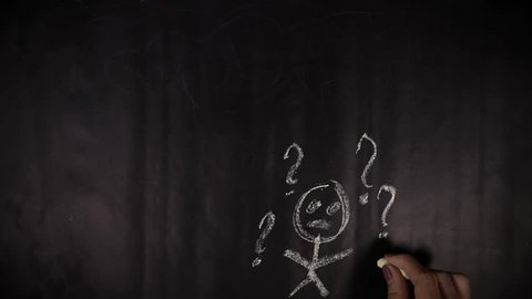 Timelapse footage of woman hand drawing question marks using a chalk on blackboard