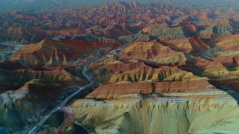 One of the most beautiful sections of Zhangye Danxia Rainbow Mountains showing striped pattern on sandstone hills. Part 1 of a 3 part series which can be merged to a continuous movie.