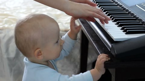 Baby curious learning to play the piano