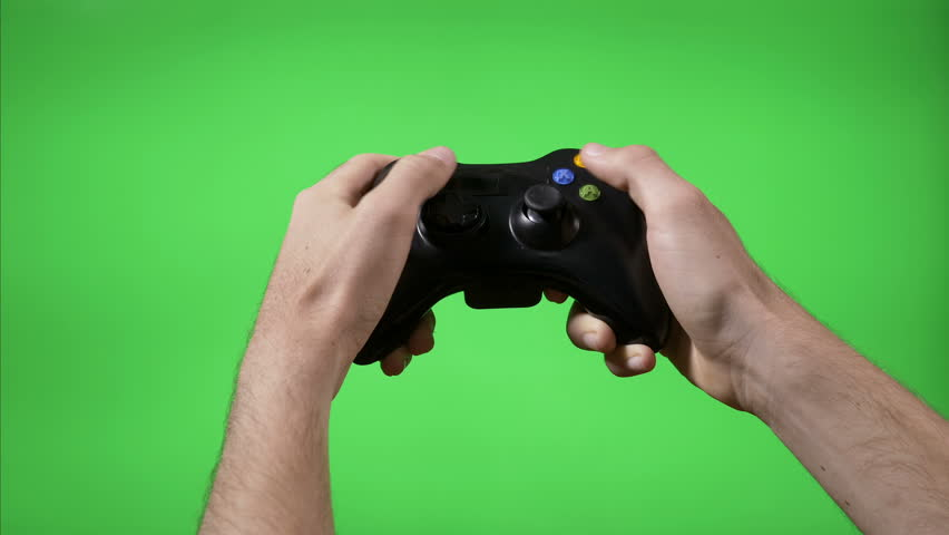 Closeup of gamer hands playing videogame pressing remote controller keys with chroma key background