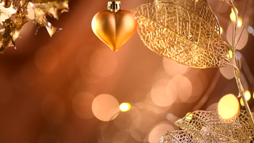 holiday golden xmas and new year glowing backdrop with hanging baubles border art design with copy space bokeh slow motion 4k uhd video