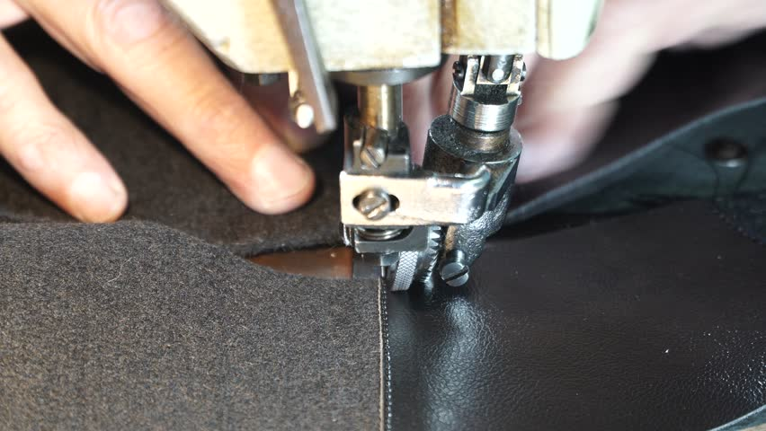 Sewing leather - sewing machine embroider on the leather - making leather shoes | Shutterstock HD Video #33573340