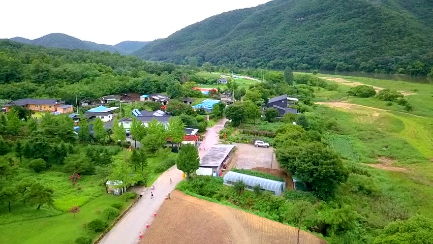 Aerial video of small village is located in the midst of nature, South korea.   Shutterstock HD Video #33581020