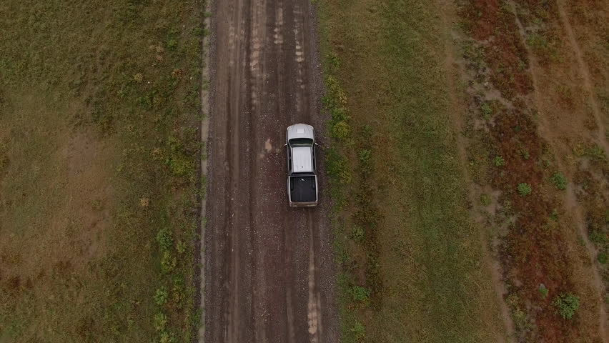 Aerial footage of travelers having expeditions on sandy rural location.Bird's view of rented car crossing offroads of desert overcoming wild natural landscape | Shutterstock HD Video #33637450