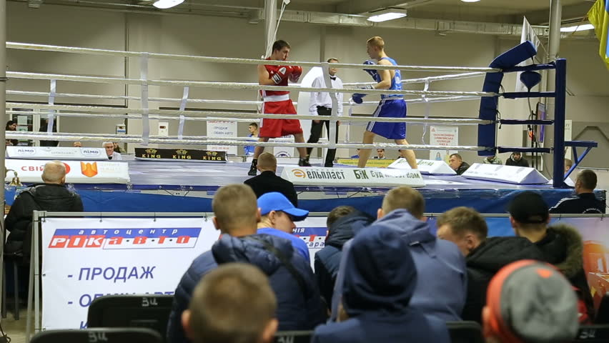 LVIV, UKRAINE - November 14, 2017 Boxing tournament. Boxers fight in boxing ring on tournament. Steady cam shot. | Shutterstock HD Video #33655060