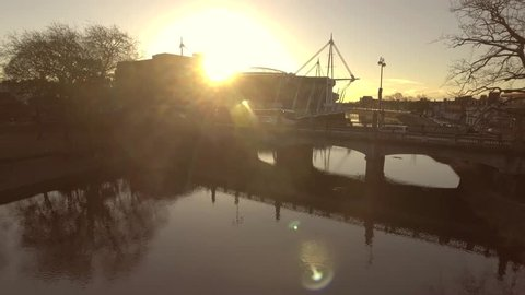 Rising aerial view of Sunrise of the river in Cardiff, UK.