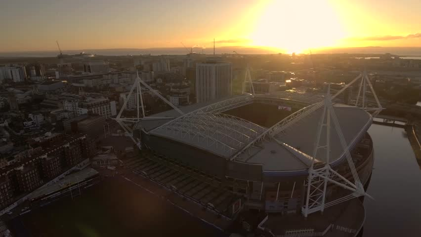 CARDIFF, UK - 2017: Panning aerial view of the Millennium Stadium / Principality Stadium in Cardiff at sunrise.